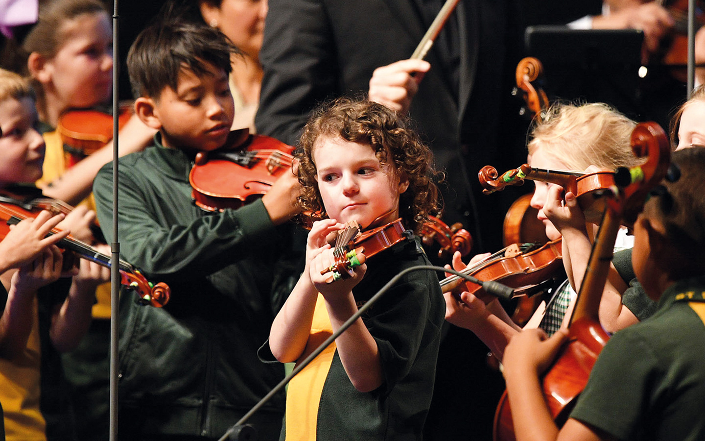 Child from St Marys school learning to play the violin.