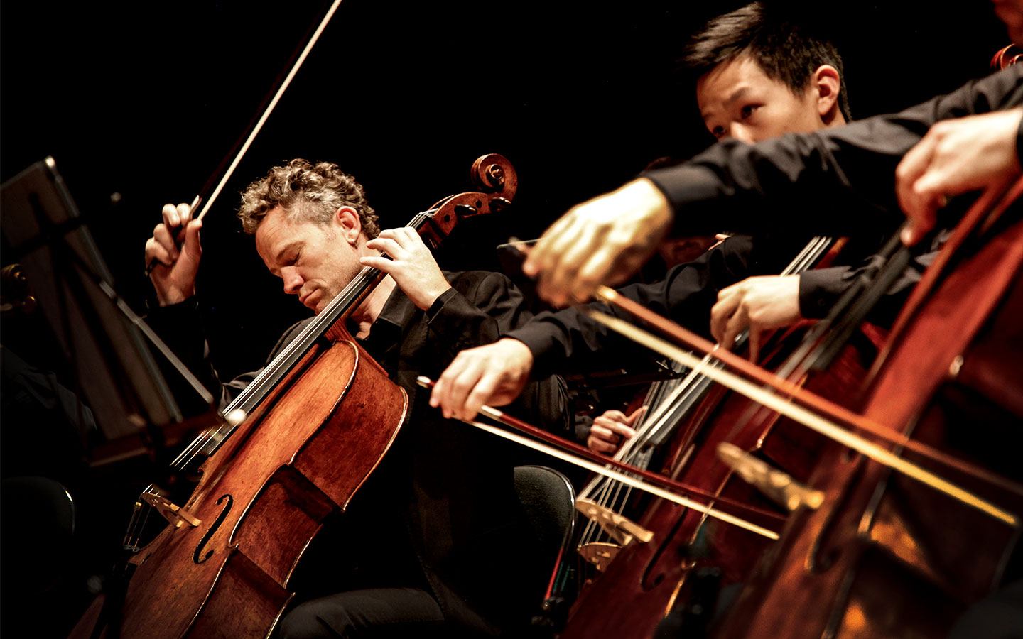 ACO Cellist Julian Thompson performing onstage